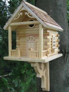 'birdcabin'  nailed to a tree, but then you can't clean it....