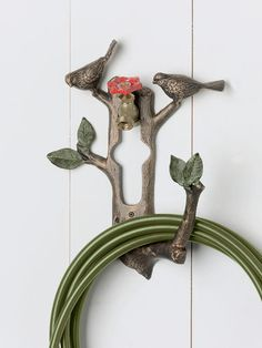 SPI Home 33107 Bird and Branch Hose Holder: Protect your hose - brought to you by SPI, who's diverse selection of products is valued by prominent interior designers and home décor specialists. Garden Hose Storage, Garden Hose Holder, House Plants Decor, Plant Decor, Hose Hanger, Hangers, Sunrise Home, Garden Crafts, Garden Ideas