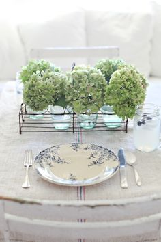 farmhouse table setting: antique french bar glass carrier to hold hydrangeas