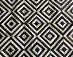 LIFESTYLE by Cara - Barrio Norte cowhide patchwork rug - black + off white