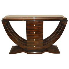 Macassar Art Deco Console   From a unique collection of antique and modern serving tables at http://www.1stdibs.com/furniture/tables/serving-tables/