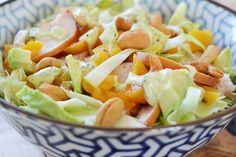 Salade spitskool, gerookte kip, abrikoos, avocado, cashewnoot