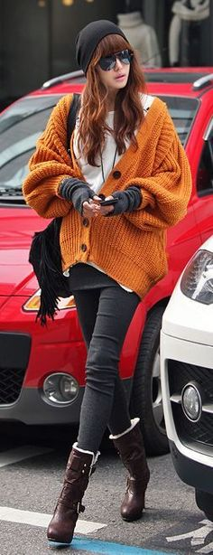 9e4859107087 Love the orange oversized cardigan. Great look for autumn winter