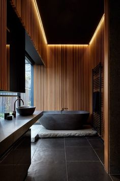 Locally Sourced Wood Was Used In This House Interior To Create A Cozy Feeling Bathroom Design Ideas - In this modern bathroom, hidden lighting creates a soft glow around the edges of the ceiling, while the wood slats create a ba. Interior Design Minimalist, Home Interior Design, Interior Ideas, Modern Home Interior, Modern Interiors, House Interiors, Interior Lighting Design, Modern Ceiling Design, Modern Design