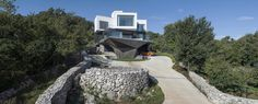 Gumno House is a contemporary residence boasting a total area of 930 sqm that currently serves the living needs of a large family in Croatia,
