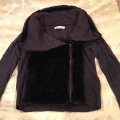 Nice Loft sweater with faux fur great condition Beautiful loft sweater. Gray with black faux fur on the collar and in the front. Has a zipper in the front. Worn once or twice. Great condition. LOFT Sweaters