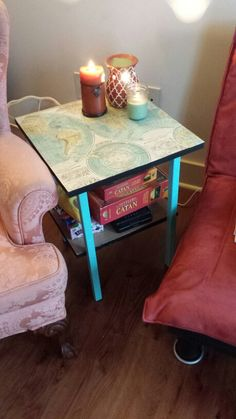 Painted table legs and trim... modpodged a $5 nap on top.. it's like a whole new table