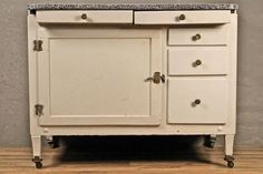 A great kitchen storage piece that doubles as extra counter space. Once functioned as the bottom of a Hoosier cabinet, it has 2 metal-lined bread drawers, and a large cabinet with a small drawer and...