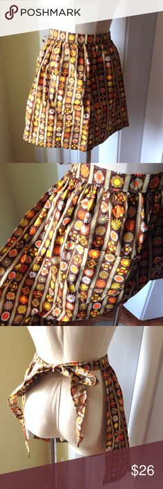 Vintage 60's-70's waist Apron Floral handmade Beautiful handmade and vintage 60's-70's waist Apron. Brown, Orange and yellows.  In fantastic condition. Best fit medium. But can tie around a small waist & even a large. Vintage Accessories