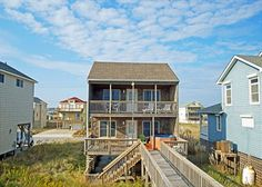 This beachy oceanfront house is located in Kill Devil Hills.  It sleeps up to 9 in its 4 bedrooms.  Come stay in Ocean Breeze!