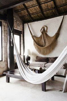 Hammocks inside straw hut