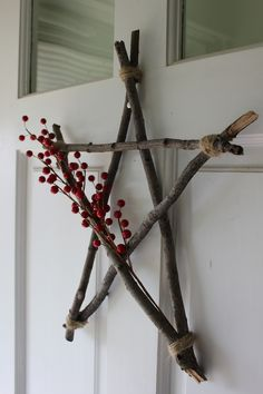 A star I made from branches, glue, twine, and berries. Love how it turned out!