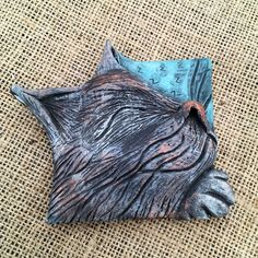 A personal favourite from my Etsy shop https://www.etsy.com/uk/listing/459938266/sleeping-cat-sculpture-sleeping-cat-art