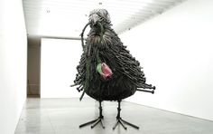 Will Ryman creates his own bird out of thousands of nails, proving his mastery of the arts forevermore. The artist's Bird sculpture stands 12 feet high, consisting of 1,500 nails varying in length and size to form a giant bird holding an equally massive rose in its beak.