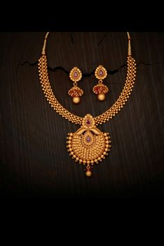 Gold ball with rubies gold necklace Gold Bangles Design, Gold Earrings Designs, Gold Jewellery Design, Necklace Designs, Silver Jewellery Indian, Kerala Jewellery, Gold Jewelry Simple, Gold Necklace, Necklace Set