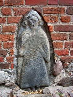 An ancient Wendish, (Slavic), stone to be found at St. Marienkirche in Bergen auf Rugen. It is either the gravestone of the Prince Jaromar I. († around 1218) or, possibly a depiction  of the Slavic God, Svantevit, or one of his priests. The picture is from Wikipedia.
