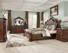 Ledelle Sleigh Headboard Bedroom Set with Upholstered Faux Leather in Brown