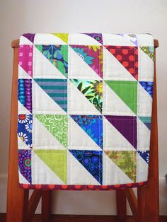 No small prints. Bold colors in solids, dots, stripes, Med and large prints.  Simple machine quilting.