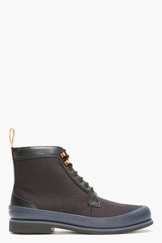 """SWIMS Black & Navy Rubber-Trimmed Harry Boots $240  """"One thing we can't avoid is a rainy day and these waterproof boots by SWIMS will keep your toes dry on those days.""""  - http://www.ssense.com/men/product/swims/black_and_navy_rubber-trimmed_harry_boots/83289"""