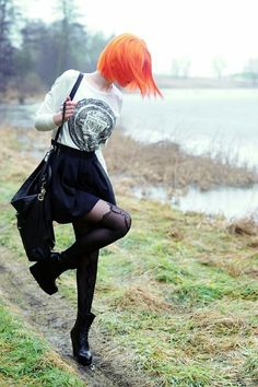 Punkish. Boots. Skirt. Bright Orange Shirt. Long Sleeve Shirt. Purse.