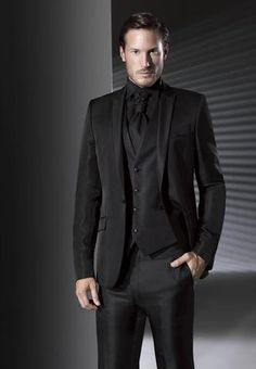men dressed in black suits black shirt and black tie | not ...