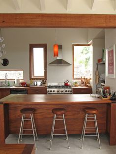 i usually don't love wood kitchens, but with tolix stools this would be perfect....