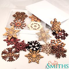 2012 Special Edition Collection - Exotic Woods - Laser-Cut Wooden Holiday Snowflake Ornaments - 3 Inch Diameter - Set of 16 in Gift Box. $55.00, via Etsy.