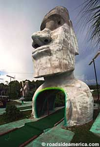 The ultimate Old School miniature golf attraction with a giant Tiki head, Sphinx, and dinosaurs. Tiki Head, Miniature Golf, Easter Island, Panama City Beach, Old School, Mount Rushmore, Lion Sculpture, Florida, Backyard