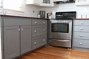 16 Modern Grey Kitchen Cabinets To Inspire You : Small Kitchen Idea With Gray Kitchen Cabinets And Drawers Also Stove And Wooden Floor Along With Wooden Countertop Best Kitchen Cabinet Paint, Repainting Kitchen Cabinets, Two Tone Kitchen Cabinets, Kitchen Cabinet Colors, Grey Cabinets, New Kitchen, Kitchen Decor, Kitchen Colors, Upper Cabinets