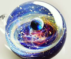 Give your Christmas tree an out of this world touch by accenting it using these celestial space ornaments. Each uniquely styled glass ornament displays an entire universe in brilliant color – complete with swirling gasses, stars, and planets.