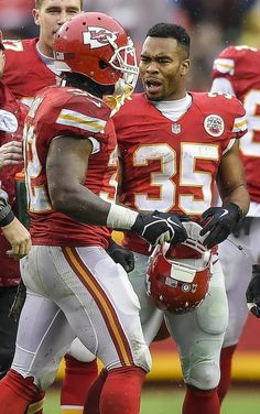 Kansas City Chiefs running back Charcandrick West (35) gave teammate Spencer Ware (32) encouragement as Ware left the field in the second quarter with a rib contusion against the San Diego Chargers on Sunday, December 13, 2015 at Arrowhead Stadium in Kansas City, Mo. The Chiefs won, 10-3.