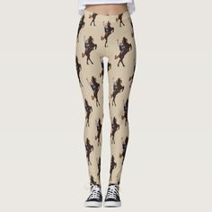 Desert Sand Last of the Pony Riders - Leggings - These cowboy print leggings feature a vintage drawing of Gene Autry astride his beautiful horse, Champion, and have been hand-colored with great care.  On a desert sand field, the cowboy pattern will add a little country style to your outfit.  Whether you pair it with a tank for your workout, a TShirt for lounging, a denim shirt for a casual look, or a nice big sweater for a little more formal look, your legs will look fabulous! #Cowboy #Farm…