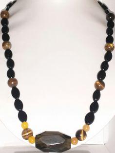 Eye of the Tiger.... Tiger a Eye beads, Black and Yellow Glass Beads, with center a Black Bead  Web: bijoubynija.com Facebook: Bijou By Nija