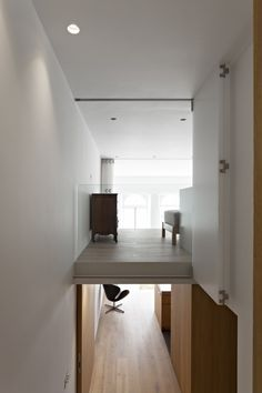 De Vere Gardens VW+BS Architects Remodelista Side View - Stairs - note fold-back door
