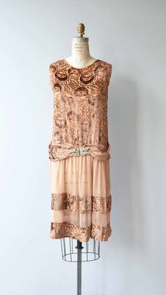 Vintage 1920s pale terra cotta devoré silk dress, the delectable combination of silk velvet and silk chiffon, with drop waist, large and decadent rhinestone belt buckle, entire devoré back and repeated at the hem. A show-stopper, of course.  --- M E A S U R E M E N T S ---  fits like: small bust: best fit up to 33 waist: best fit up to 31 hip: best fit up to 33 length: 39 brand/maker: n/a condition: very good, some light/minor wear under the arms  to ensure a good fit, please r...