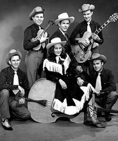 Hank, Audrey, and the Drifting Cowboys.  This time there's a bit more unified look between Hank & the band, but he's still the only one in a suit.  -Julie