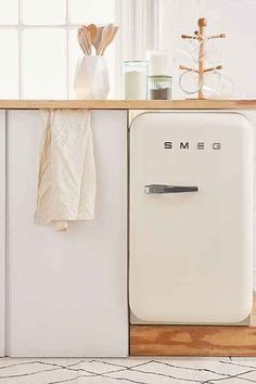 SMEG Mini Refrigerator - Perfectly retro mini fridge with all the modern updates you need. Features absorption cooling, LED lighting + plenty of shelving options inside. Home Design Decor, Interior Desing, Küchen Design, Interior Lighting, Diy Home Decor, Design Ideas, Decor Crafts, Smeg Fridge, Classic Kitchen