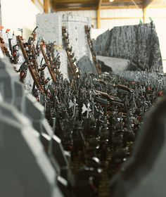 We've all seen some incredible LEGO builds before, but this one, by Rich-K & Big J, takes the cake as one of the most impressive pop culture recreations of all time! About 150,000 LEGO bricks and 1,700 mini-figures were used to recreate the Helm's Deep battle scene from Peter Jackson's The Lord of the Rings. It took the duo about four months to construct the 160 pound, ping-pong table size creation. Look closely and you'll notice the small details like the catapults, ladders and towering…