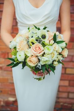 ivory and blush rose, ranunculus and anemone bouquet by Flourish Designs