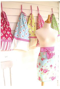 Laundry bags!  I think I could do these in a light canvas for boys room (obviously not in flowers) and personalize them.