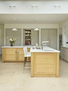 This magnificent kitchen from Martin Moore is the new heart of a family home. A place where three generations come together to cook, eat, relax and enjoy quality time martinmoore.com