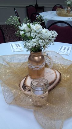 Centerpieces... Gold spray painted mason jars