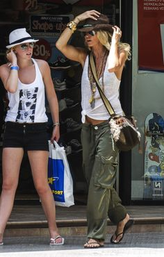 girl on the right ~ baggy pants, white tank, cross over bag, hat...yes I want !