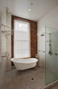 love the tub in the shower i would choose a different wood-like tile and maybe change the brick to wood if that would work