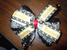 Pittsburgh Steelers hair bow by DixieMadeBows on Etsy