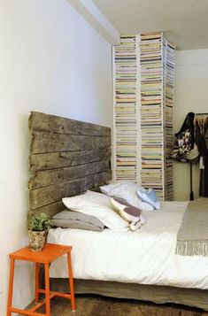 rescued headboards! why pay tons of money for a headboard when you can use a door or branches or old fence? so cool.