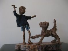 Fetch boy with dog sculpture by Stephaniessculptures on Etsy