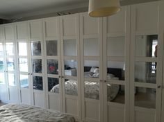 Ikea Bergsbo wardrobe doors, mirrors sticked with mirror silicone.
