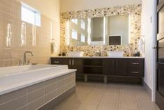 Top designers and decorators offer their best on how to deal with small bathroom remodeling.