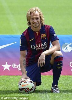 Ivan Rakitic poses during his presentation at the Camp Nou...
